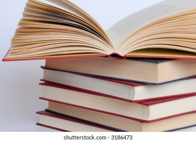 Open book on books stack