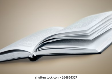 Open book  on brown background