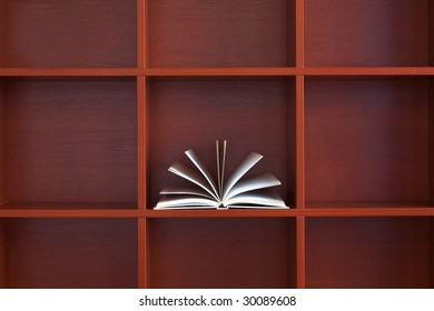 open book on the brown shelf
