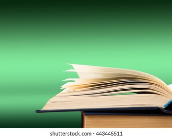 Open book on the color gradient background, space for text