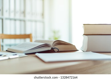 Open book on desk in law firm office, selective focus