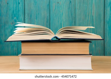 Open book on the desk over wooden background