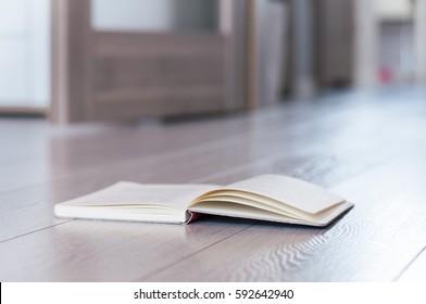 Open book on the floor.