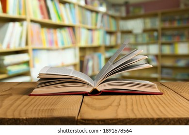 Open book on old wooden table