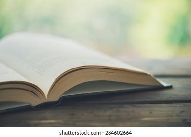 Open book on a rustic desk - Split toned