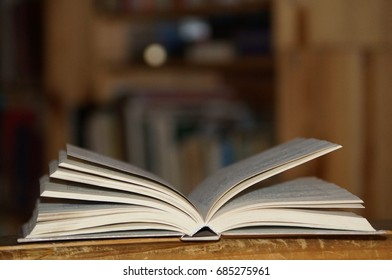 Open book on the shelf