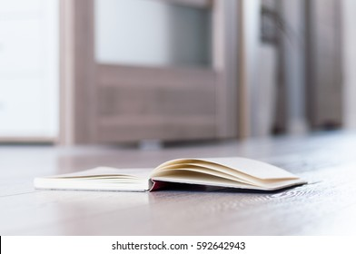 Open book on the sofa.