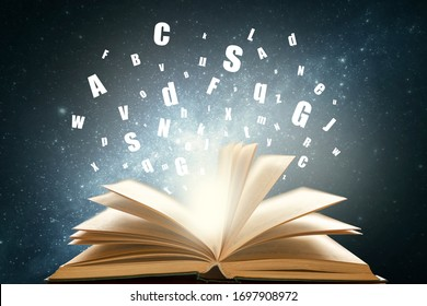 Open book on space background with letters, alphabet