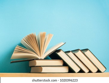 Open book on stack of books on wooden table. Education background. Back to school. Free copy space.