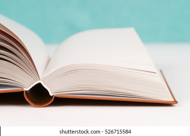 Open book on table. Back to school. Copy space. Top view.