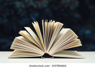 Open book on the table with dark background