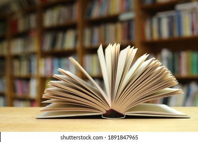 Open Book on the table in library