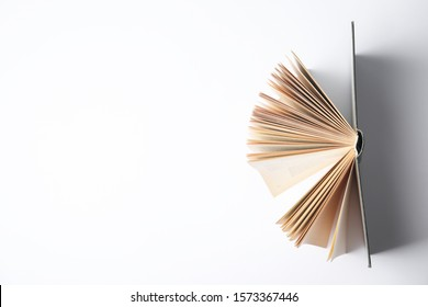 Open book on white background, top view