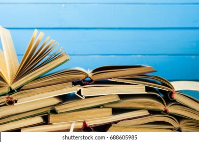 Open book on an white wooden table. Beautiful blue background.