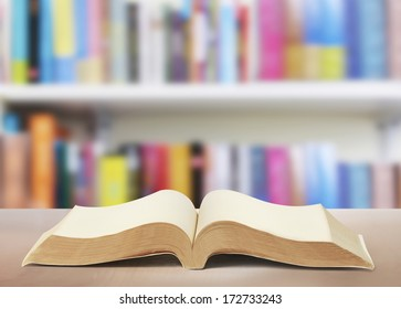 Open book on wood planks