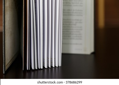 Open book on wood table.