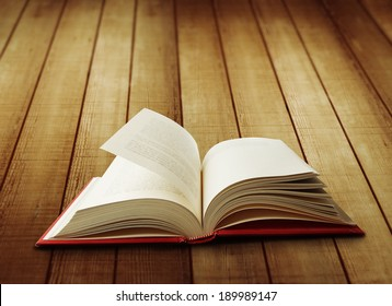 Open book on wooden boards