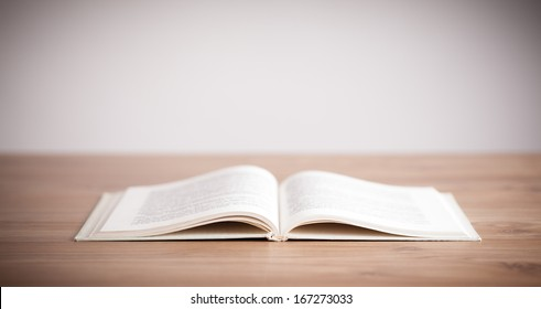 Open book on wooden deck and copy space