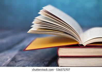 Open book on wooden floor
