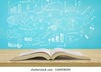 Open Book on wooden table with illustration