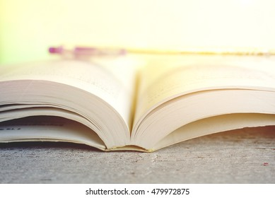 open book and a pen  in soft vintage  tone background