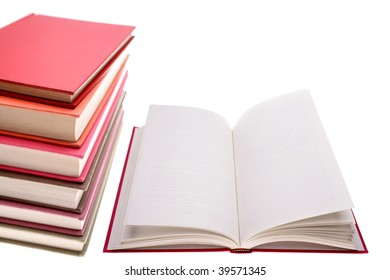 Open book and pile of books on white background.
