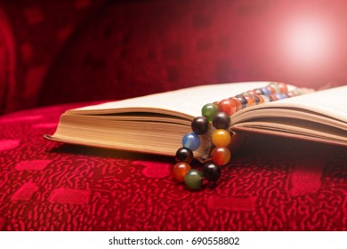 Open book Quran and rosary beads. religion of Islam. Concept of enlightenment, acceptance of faith.