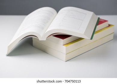 Open a book and a stack of books on the table