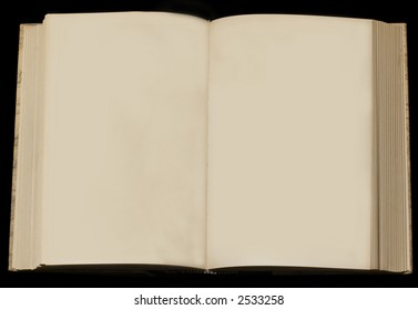 open book with two yellowed empty pages on black background