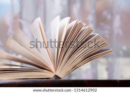 open-book-wood-table-450w-1314612902.jpg