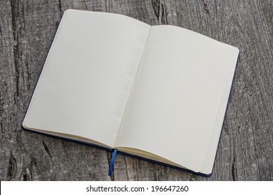 Open book in wooden background