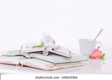 Open books with flowers and coffee in the morning, Vintage tone.