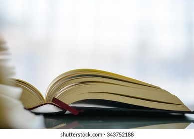 open books on glass table