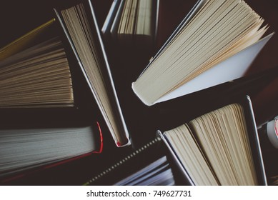 Open books on the wooden table. Closeup of pages. Abstract concept of knowledge, education, learning, and literature.