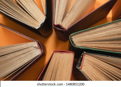 Open books on a yellow background. Top view.