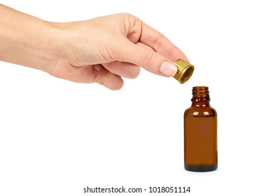 Open bottle with medical elixir, syrup for colds, antipyretic suspension in hand. Isolated on white background. Health and medicine.