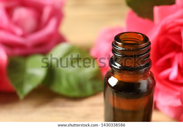 Open Bottle Rose Essential Oil On Stock Photo (Edit Now