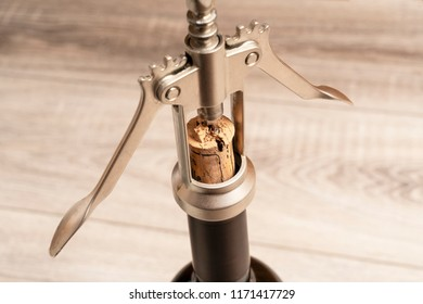 open a bottle of wine with a corkscrew