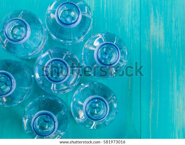 Open Bottles of Still Mineral Water