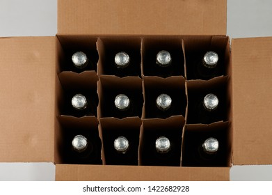 Open box with champagne bottles above top view