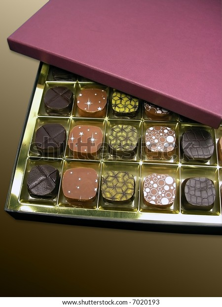 An open box with the chocolates, isolated
