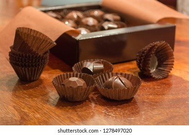Open box of filled chocolate. Making homemade artisan chocolate sweets with different fillings for a special ocassion: valentine's day, a birthday or anniversary gift or the perfect souvenir