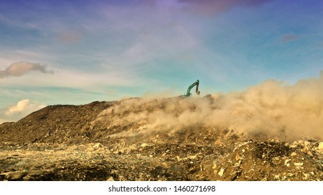 An open burning waste dump or landfill
