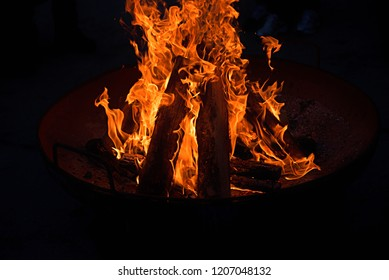 open campfire in a pan, at night. dark background