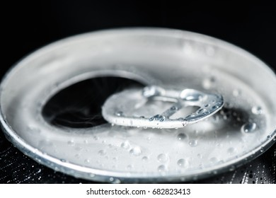 Open can of carbonated beverage bottle closeup isolated on black background