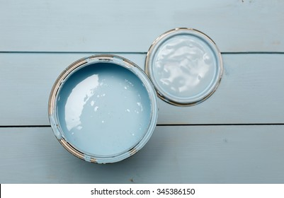 open can of paint on a wooden background