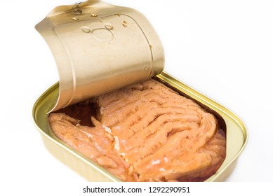 Open  canned fish. Tin can with smoked salmon fillets on a white background.