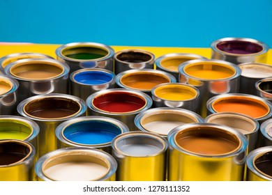 Open cans of paint, blue background