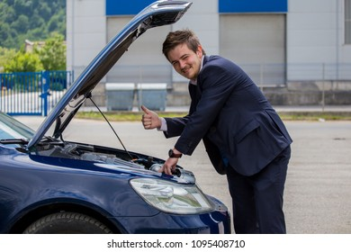 Open a car hood, the driver is happy because everything is fine, no breakdowns, no help is needed on a frequent basis