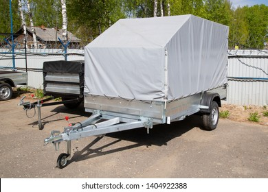 Open car trailer. Trailer store. Assembly of car trailers.